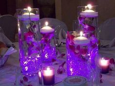 centro de mesa con velas y flores sumergidas