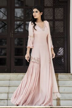 Rose pink hand embroidered tasseled blouse with volume lehenga set. Net Care: Dry Clean Only Pakistani Outfits, Indian Outfits, Stylish Dresses, Fashion Dresses, Casual Dresses, Peach Color Dress, Indian Designer Suits, India Fashion, Indian Fashion Trends