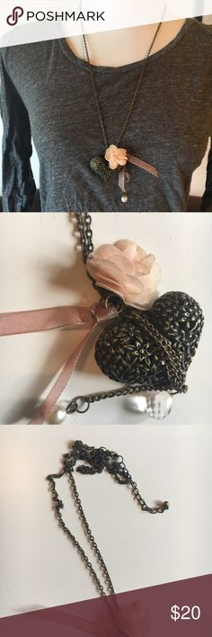 Antiqued Heart and flower long necklace Antiques bronze colored necklace featuring a heart, a flower charm and a couple of faux pearls. Really unique and gorgeous. Given to me by a friend, I believe she said it was from Anthropologie (she was working there at the time.). In good condition. Some general wear on the metal, but no structural or functional issues. Looks great, too! Feel free to ask questions! Anthropologie Jewelry Necklaces