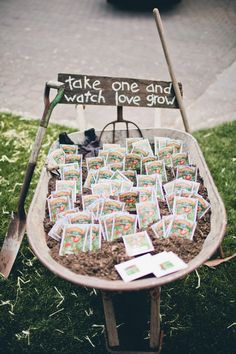 seed packet wedding favors in a wheelbarrow