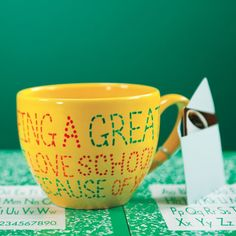 With the stroke of a paint pen made for pottery (we used a Pebeo-brand Porcelaine 150 with a bullet tip), kids can turn an ordinary mug into a useful keepsake for their teacher.