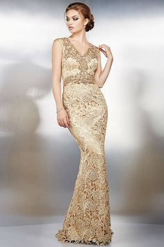 Floor length sleeveless fitted gold lace gown features crystal embellishments along the V neckline and bodice and a zipper down the back.