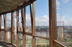 Радиусное остекление балкона «холодными» конструкциями из алюминиевого профиля
