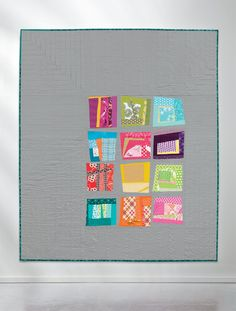 Pair Log Cabin blocks with Courthouse Steps and String blocks in this wonky, happy baby quilt by Kati Spencer.
