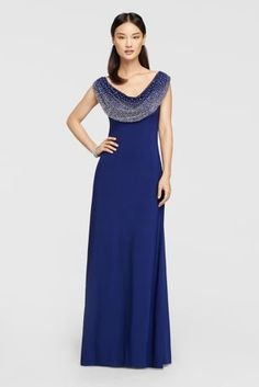Looking for a little glamour for the mother of the bride or groom? This sleeveless gown is stunning with a floor-length skirt and beaded cowl neck.   By Cachet  Jersey  Side zipper; fully lined  Spot Clean  Made in the USA Protect your dress before you wear it with our Garment Bag.