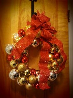 DIY Holiday Ornament Wreath to hang outside your holiday party entrance! #holidayparty