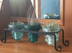 Found the small clay pot holder for $1, had the glass insulators which fit perfectly. Added air plants, no dirt needed!