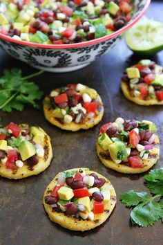 Grilled Polenta Rounds with Black Bean and Avocado Salsa Recipe on twopeasandtheirpod.com This easy appetizer is always a hit at parties!