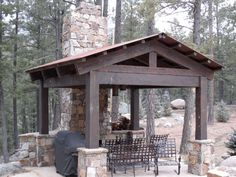 Timberline Framers Inc, Pagosa Springs, Colorado. Timber gazebo. Outdoor grilling area and fireplace.