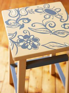 diy Top-Down Design  Craft a conversation piece by adding a large-scale floral pattern to the top of a colorful barstool. After painting the stool to match your color scheme, freehand-draw a fun design on top or use a stencil