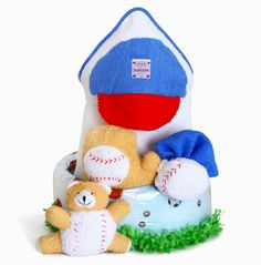 Little Slugger Diaper Cake will hit a home run with the new parents right off the bat. Not only is it visually exciting, it also includes the following essential items for baby: 18 disposal diapers (size 1) Hooded towel with baseball cap applique/embroidery on hood Baseball themed bath mitt Baseball themed bath toy Bath Sponge Baseball themed soft toy