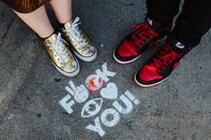 Graffiti from the Fitzroy area found during a recent Engagement shoot in Melbourne, exploring the trendy graffiti filled laneways of Fitzroy and Collingwood.  Complemented by uber cool Black and Red Nikes and blinging Gold Converse choice. Melbourne Engagement Photographer: Marisa from Cadence and Grace Photography