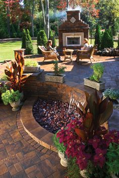 Patio with fireplace and water feature