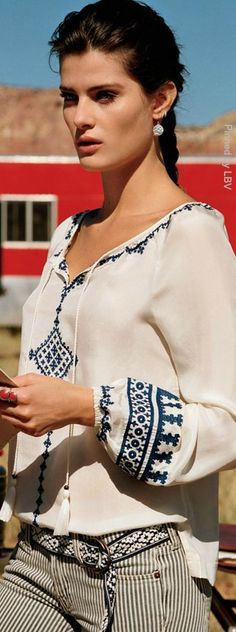Love the embroidery on this blouse!  It looks like one of the regional embroidery styles from the Baltic region