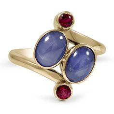 The Carondelet Ring.  Two dreamy natural star sapphire cabochons are delicately cradled between two natural ruby accents in this mesmerizing Retro piece.  [I love this ring.]
