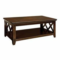 """Hardwood coffee table with lattice detailing and a bottom display shelf.   Product: Coffee tableConstruction Material: Quartered oak veneers and solid hardwood Color: Dark tobacco Features: Bottom display shelfLattice detailing   Dimensions: 18"""" H x 48"""" W x 26"""" D"""