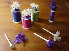 Golf Tees for Bobbins/Thread - Pickup Some Creativity; Golf Tees hold the bobbin with the thread.
