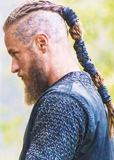 Ragnar left side tatoo.