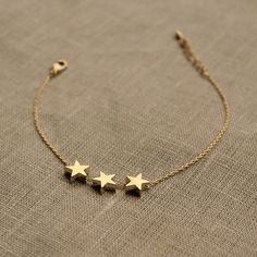 Delicate Three Star Bracelet delicate gold three star bracelet by little nell Cute Jewelry, Modern Jewelry, Gold Jewelry, Gold Necklace, Delicate Jewelry, Choker Necklaces, Jewelry Stand, Jewlery, Diamond Bracelets