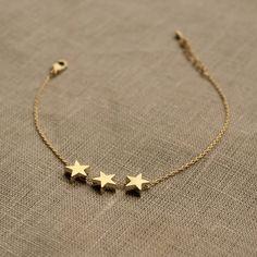 Delicate Three Star Bracelet delicate gold three star bracelet by little nell Cute Jewelry, Modern Jewelry, Gold Jewelry, Jewelry Accessories, Jewelry Design, Delicate Jewelry, Jewelry Stand, Trendy Accessories, Jewlery