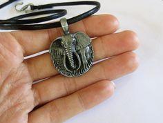 Safari Elephant Necklace - Pewter Elephant Pendant on Black Faux Leather Cord - Gunmetal Grey. $19.00, via Etsy.