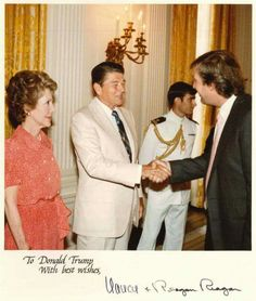 Our great President Reagan shaking hands with President Elect Trump. Passing on the conservative patriotic  spirit. One non-politician to another.