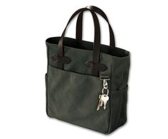 """Filson – Small Tote Bag Filson lets us know right away where this small tote bag is coming from: """"We've been field-testing our newest Small Tote and we think you'll like it as much as we do. It's just the right size for lunch, ammo or extra field gear."""" It has been in the field and carried ammunition … and lunch. Manly—and a total classic."""