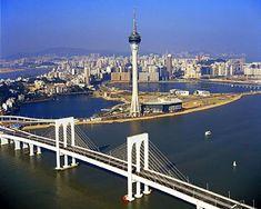 Macau Tower (澳門旅遊塔會展娛樂中心) dominates the background, with the Sai Van Bridge (西灣大橋) in the foreground.