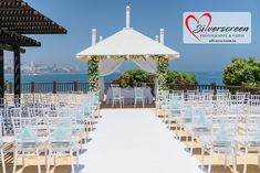 Destination Weddings Abroad. Romantic Blessing by the Sea. Fabulous Sunset Beach Club Seafront Wedding Blessing Ceremony - Chiavari chairs with blue ribbons. Perfect beach wedding and special events location.  Getting married in Spain. Creative and unique seafront wedding location #weddingday #weddingsspain #irishweddingphotographer #weddingvibes #benalmadena #weddingceremony  #sunsetbeach #SunsetBeachClub Wedding Photography by Dougie Farrelly, Silverscreen Photography & Video Sunset Beach Club, Sunset Beach Weddings, Wedding Abroad, Wedding Tips, Wedding Blessing, Destination Wedding Planner, Ceremony Decorations, Wedding Photography, Wedding Sarees