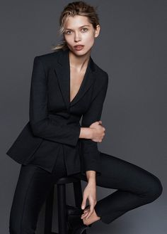 Hana poses in peplum jacket with slim-fit pants from Theory