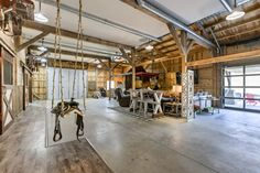 Barn house for sale in Nebraska has horse stalls for bedrooms - Curbed Saddle Swing, Saddle Rack, Barn Homes For Sale, Tractor Seat Bar Stools, Horse Stalls, Horse Barns, Post And Beam, Bedroom Flooring, Barndominium