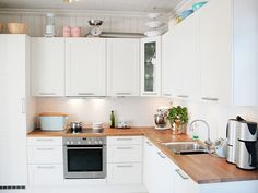 white and wood kitchen - open space above the cabinets