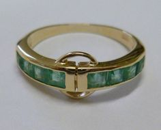 This Vintage Inspired Emerald ring has been crafted from 9ct Solid Gold. Princess Cut Emeralds are channel set with a circle enclosure under the gallery bringing this ring to life. THIS VINTAGE INSPIRED EMERALD RING IS TRULY AN EXQUISITE FINE JEWELLERY PIECE WHICH IS TO BE TREASURED FOR A LIFETIME ! • FREE GIFT BOX PROVIDED • ALL ITEMS PACKAGED IN BUBBLE BAG • SHIPPING United States - USPS, UK - Royal Mail, Australia - Australia Post • CHOOSE FROM A VARIETY OF NATURAL GEMSTONES • CHOOSE…