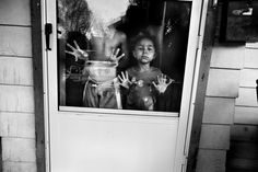 by Paolo Pellegrin Location: USA. Rochester, NY. 2012. Children of a family who lives next door to a home where a violent crime was just committed