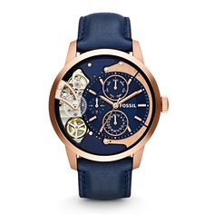 Rose gold-tone stainless steel case with blue leather strap. Fixed bezel. Blue dial with rose gold-tone hands and index hour markers. Minute markers around outer rim. Four sub-dials displaying day, da