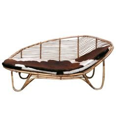Rattan Chaise Lounge | From a unique collection of antique and modern chaises longues at https://www.1stdibs.com/furniture/seating/chaises-longues/
