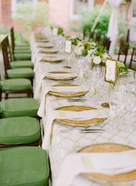 green wedding seats and gold plates