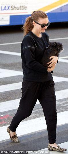 Rooney Mara: harem pants with oversized sweater and flats and sleek ponytail