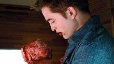 Bella (Kristen Stewart) andt   Edward (Robert Pattinson) marry.