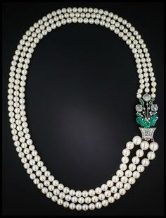 Art Deco Boucheron pearl necklace with carved emeralds and rose cut diamonds.