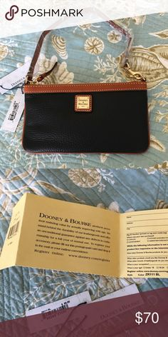 "Dooney & Bourke Black Slim Leather Wristlet Crafted in exceptionally durable pebble grain leather. This wristlets will store your cellphone, cards and other essentials. It's 8"" W x 4.5"" H, x 0.75"" D. Zip closure, 6.5"" wrist strap drop which is adjustable. Interior pocket and registration card are included. Dooney & Bourke Bags Clutches & Wristlets"