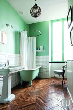 This almond green, retro style bathroom houses a plethora of vintage finds. Home Journal, February 2015