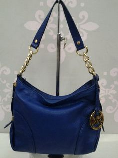 "Brand:Michael Koks  Size small Measuring 7"" H X 10 1/2"" L X 4 1/2"" D  Stap drop: 8""  Color:Blue  Material:Leather  Style # AV-1101"