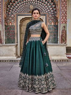 Beautifully embroidered with our signature craft Gota Patti, the Vatsala Lehenga sparkles with every step you take. The emerald green silk lehenga is perfect for any royal occasion. Style Tip: Pair this beautiful lehenga with jadau chand b Indian Lehenga, Green Lehenga, Raw Silk Lehenga, Indian Wedding Lehenga, Royal Blue Lehenga, Wedding Lehanga, Party Wear Lehenga, Bridal Lehenga Choli, Bollywood Lehenga