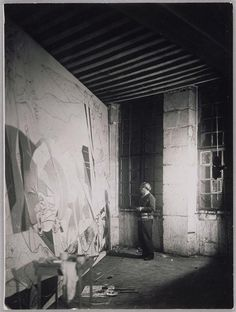 Picasso working on Guernica, 1937. Absolutely huge painting.