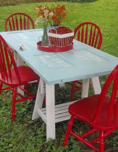 Door table..perfect color, love the red chairs.