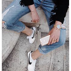 rose gold tempered glass cellphone, ripped jeans, wrist watch