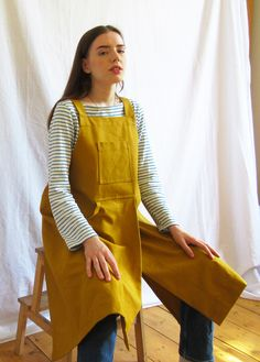 Sturdy cotton canvas, in a warm 'curry' tone, offers good protection for work, home and garden. The split skirt gives lots of movement, whilst ensuring each leg is perfectly covered when sitting at the wheel or work bench. Fantastically comfortable design, with cross back straps, no ties around the neck - bib pocket for small tools, roomy side pocket, loop for cleaning cloth etc. Split Legs, Split Skirt, Back Strap, Petite Size, Mustard Yellow, Cotton Canvas, Apron, Skirts, Clothes