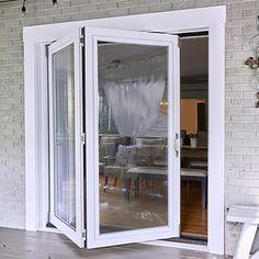 Half-way closed patio door from exterior of home