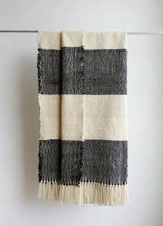 Chunky black and white boho bedding wool woven throw blanket Perfect for bed, sofa or couch, this woven knit blanket is made of merino wool. The handwoven blanket is handmade in a wood hand loom and its the perfect special gift for you or the one you love.  I love this throw wool blanket because it be use at: bed foot board, Sofa, Outside, when you are travelling, at bed reading a book, looking a movie, where you can imagine!   SIZE: Width: 37 ̈ / 94 cms Length: 75 / 190 cms  COLOR: Black…